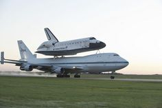 Space Shuttle Endeavour is ferried by NASA's 747 Shuttle Carrier Aircraft (SCA) over Ellington Field in the early morning hours of September 20, 2012 as it departs for California.