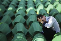 A Bosnian Muslim man sits and cries near the coffin of his relative before a mass burial, near Srebrenica July 11, 2012. The bodies of 520 recently identified victims of the Srebrenica massacre will be buried on the anniversary of the massacre when Bosnian Serb forces commanded by Ratko Mladic slaughtered 8,000 Muslim men and boys and buried them in mass graves, in Europe's worst massacre since World War Two. (Reuters photo)
