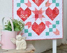 star crossed love pdf quilt pattern valentine quilt wallhanging What Quilt Pattern Is This – Quilt Design Creations Quilt Baby, Heart Quilt Pattern, Quilt Patterns, Small Quilts, Mini Quilts, Cross Love, Picnic Quilt, Quilted Wall Hangings, Hanging Quilts