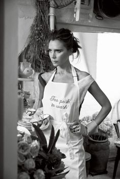 Victoria Beckham a.k.a. Posh spicing up the kitchen in a fab-funny apron.
