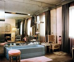 Syrie Maugham (1879-1955) was a legendary Interior Designer. She pioneered all white rooms in the 1920s and '30s, and made great use of mirror.