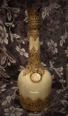 Beautiful cream painted bottle with applique
