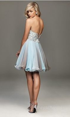 This hemline is made curly with fishing line. I want to try it because organza is so cheap and great!