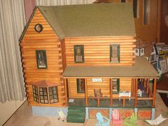 """This beautiful Log Cabin doll house was built by Ellen M. of St. Paul, MN.  She named this beauty """"The Duchy""""!"""