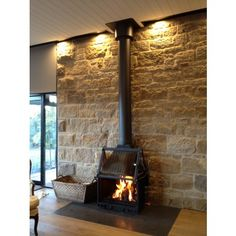 Cheminees Philippe world leaders in beautiful French fireplaces and cast Iron wood heating. Slow combustion efficiency and style. Open Fireplace, Stove Fireplace, Living Room With Fireplace, Fireplace Design, Scandinavian Fireplace, Artificial Fireplace, Stone Feature Wall, Freestanding Fireplace, Shed Homes
