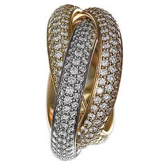 Diamond Trinity ring with 18K yellow, white, and pink gold bands, $31,400, Cartier. A ring for our right hand, anyone?