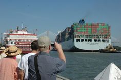 Savannah, Ga.: The Cosco Development, the largest container ship to ever call on an East Coast port, passes as a crowd