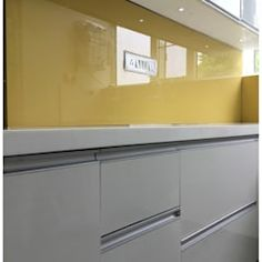 Yellow lacquered glass as backsplash in kitchen modern kitchen by u and i designs modern Best Kitchen Designs, Modern Kitchen Design, Modern Design, Kitchen Tall Units, Lcd Panel Design, Tv Unit Furniture Design, Tv Unit Decor, Glass Kitchen, Kitchen Backsplash