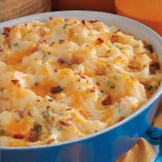 This recipe takes mashed potatoes and traditional baked potatoes and combines them. Mashed potatoes get sour cream, bacon, green onions, and cheese, and are baked.