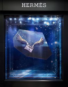 https://flic.kr/p/7m6oEU | WingsPlusBirkin | Paper wings I have just designed and engineered for the Hermès Christmas windows here in Sydney.  Photography: Murray Fredericks