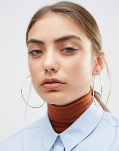 These ASOS Large Hoop Earrings would work well with some slicked back hair and a red lip.