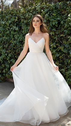Jenny By Jenny Yoo Bridal The Presley gown features a classic A line ball gown silhouette with a mo&; Jenny By Jenny Yoo Bridal The Presley gown features a classic A line ball gown silhouette with a mo&; Western Wedding Dresses, Wedding Dresses With Straps, Classic Wedding Dress, Dream Wedding Dresses, Wedding Gowns, Preppy Wedding Dress, Delicate Wedding Dress, Modest Wedding, Wedding Dress With Pearls