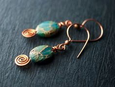 Amazing green-blue-aqua-terra-jasper-copp earrings from Etsy. I've heard this stone called many different things: impression stone, aqua terra stone, sea sediment Jasper, water stone & even 'variscite'-whatever the name, it's beautiful!