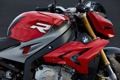 """BMW S 1000 R 2014. BMW claims the output of its superbike motor has been tuned to """"optimize low to mid-range performance."""" Maximum rpm has been reduced by roughly 2,000, and the maximum horsepower and torque peaks have been brought down as well. Torque output below 7,500 rpm is significantly higher than achieved by the pure superbike S 1000 RR engine."""