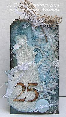 Berdien Weideveld: http://scrapfrombemmel.blogspot.co.nz/2011/12/12-tags-of-christmas-tag-4.html#