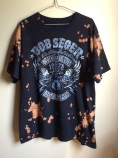 This shirt is a one of a kind, each splattered shirt is different. This one is a Bob Seger Rock and Roll Never Forgets Tour tee , all cotton.