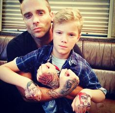 John and his son Xavier! Aw they both have the same smolder lol