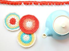 """These precious coasters are modern with a vintage vibe. Perfect to use up leftover yarn! Very easy, and even includes pictures to show you how it looks as it's being crocheted."""