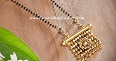 With the wedding season upon us explore our collection of fresh mangalsutra designs. Bold or subtle light or heavy classic or unique. Let your mangalsutra reflect your personality. The sleek single line black beads chain attached to a unique antique gold pendant in different design.