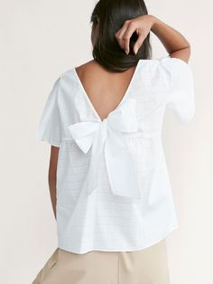 Spring summer 2017 Women´s CHECKED TEXTURED WEAVE TOP WITH BOW DETAIL at Massimo Dutti for 199. Effortless elegance!