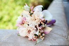 Blush pink wedding bouquet by www.theflowerhouse.com
