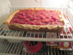 Homemade cold strawberry pie, chilling in fridge
