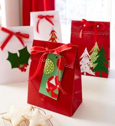 A die-cutting machine and decorative-edge punches make it easy to embellish gift bags and tags with holiday fabric.