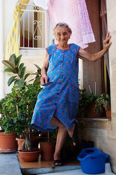 A cute lady at any age can wear a fun floral dress.   (On the Street……The Grand Nonna, Bari)