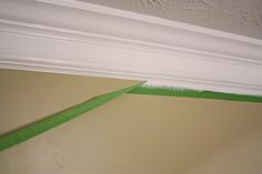 Two pieces of crown with wall painted same color as crown molding between the two pieces. good tips on installing cheap crown molding and making it look expensive and heftier from Bower Power Cheap Crown Molding, Faux Crown Moldings, Moldings And Trim, Diy Molding, Ceiling Crown Molding, Molding Ideas, Baseboard Molding, Wood Molding, Home Renovation