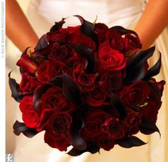 Crimson roses & black calla lilies... I loved them together so much that I had my florist duplicate this as my wedding bouquet! ;D