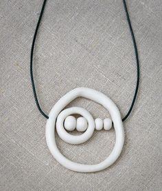 Interesting asymmetric porcelain pendant necklace. Handmade porcelain. Gift for her. #ceramic jewelry #porcelainjewelry #ceramicpendant #ceramicnecklace