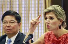 Queen Maxima of the Netherlands, the U.N. Secretary-General's Special Advocate (UNSGSA) for Inclusive Finance for Development, gestures during a news conference in Manila July 1, 2015. Queen Maxima is attending the National Strategy for Financial Inclusion on Wednesday during her two-day official visit. At left is Central Bank governor Amando Tetangco. REUTERS/Romeo Ranoco
