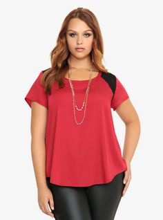 Short-sleeved and stylish, this black and red colorblock raglan features see-through mesh shoulders. It's lightweight with a rounded hemline and perfect for a simple, sexy look.%0A