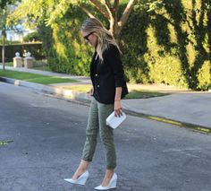 Army pants, preppy navy blazer, and striking white pumps