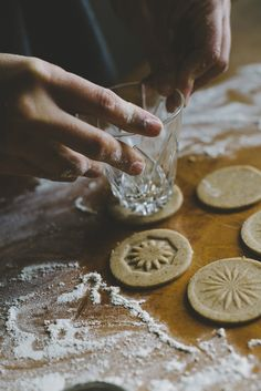 Winter Cookies by Babes in Boyland.  Great idea: Use the bottom of crystal scotch or rocks glasses to imprint cookies.