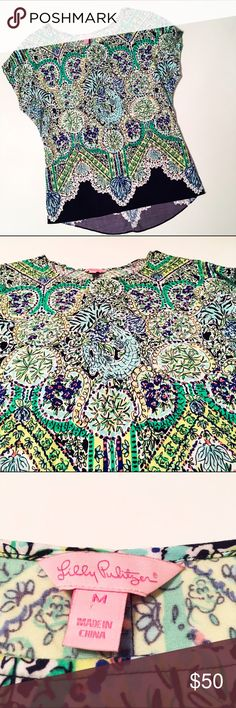 Lilly Pulitzer Printed Top This is a NWOT Lilly Pulitzer printed shirt. 100% rayon. Features a pretty flower design with a cat and alligator hidden within. Features a high-low hem. True to size. Lilly Pulitzer Tops Tees - Short Sleeve
