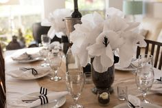 Black, White and Neutral Tablescape - how fab are these handmade crepe paper poppies as a baby shower centerpiece?!