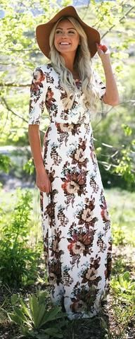 """Michelle Maxi Dress This wonderful maxi dress has a beautiful floral print and is simple shape is flattering and comfortable for everyone and is definitely one of our summer must haves. Fit: Use Woven Size Chart, click here for size chart Total Length: XS-S 55"""", M-L 55.5"""", XL-2XL 56"""" Colors: White w/ Floral Print Fabric: 95% Polyester, 5% Spandex Modest Cruise apparel"""