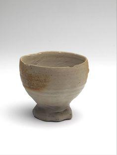 beaker on foot 1450 - 1550 Dimensions h. 7.2 x diam. 7.8 cm Material and technique stoneware, iron engobe