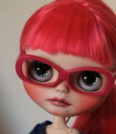 Cute with her red glasses and red hair