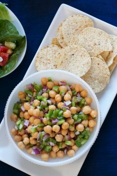 Basic chickpea salad - Combine a drained can of chickpeas with 1/2 red onion, diced; 1/2 green pepper, diced and 2 cloves of garlic, minced. Top with 2 tablespoons of olive oil and 1 tablespoon red wine vinegar, add salt and pepper and mix. Serve with chips for dipping or enjoy as is.