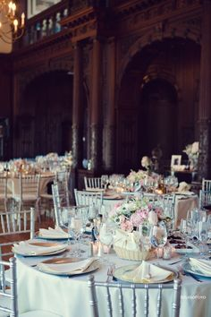 Gorgeous. Main room, why I'd love silver chiavari chairs. Though I think I'd prefer white linens, and the centerpiece doesn't go with my colors.