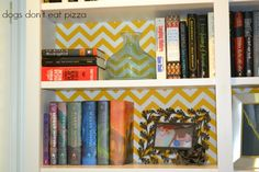 Brighten Built-Ins With Fabric, using poster board, duct tape, fabric and a staple gun, I lined the back of the bookcases with fabric