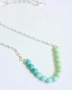 Make your own cool-colored gradient necklace.