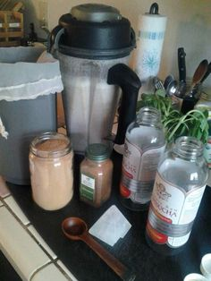 Almond milk prep w/ raw carob powder & cinnamon.