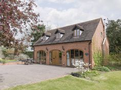 This luxurious property has lovely countryside views and a large garden.