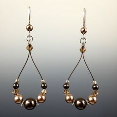 """- Swarovski crystals and Swarovski crystal pearls - Hand formed Sterling silver earwires with rubber earring backers - Beads are strung on a colored, stainless steel nylon coated cable for durability - All metal components are 100% .925 sterling silver - They measure approximately 2-1/2"""" L x 1"""" W."""