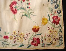 Detail embroidery, apron, England, late 18th century. Cream silk with colorful silk satin-stitch floral embroidery bordering the apron and with naturalistic pink carnations on the corners.