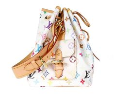 View this item and discover similar for sale at - This is a bucket bag by Louis Vuitton. It's white leather with multicolor monogram. The bag has two small side pockets with belt buckle closure. Louis Vuitton Multicolor, Bag Sale, Keds, Purses And Handbags, Belt Buckles, White Leather, Bucket Bag, Shoulder Strap, Monogram