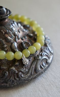 Jade beaded bracelet with pave crytal charm.
